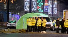 Police attend the scene of the crash in George Square  in Glasgow in which six people were killed. Photograph: Jeff J Mitchell/Getty Images.