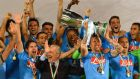 Napoli players celebrate their victory as they hold their trophy after defeating Juventus FC in the Italian Super Cup final at the Al Sadd Stadium in Doha, Qatar. Photograph:  EPA