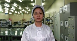 Dao (28) is one of over 4,000 workers at Flexcom's factory in the Yen Phong Industrial Zone. She earns the equivalent of €175 a month packing electronic components. Photograph: Catherine Healy