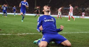 Chelsea's Cesc Fabregas celebrates scoring his sides second goal of the game against Stoke City   at the Britannia Stadium. Photograph:  Martin Rickett/PA Wire