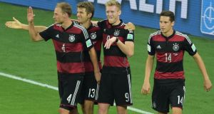 Germany's forward Andre Schürrle (2nd r) celebrates with team mates after scoring the seventh against Brazil  in Belo Horizonte. Photograph: Gabriel Bouys / Getty Images