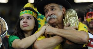 Brazil fans dejected after the 7-1 defeat to Germany  at Estadio Mineirao  in Belo Horizonte. Photograph:  Chris Brunskill Ltd/Getty Images