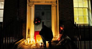 'Nobody could disagree with the fact that the three charities the Belvedere Sleepout support are worthy recipients. But what was appropriate 31 years ago as a charity endeavour is surely now outdated.' Above, a man lights a candle outside at the doorway in Molesworth Street where Jonathan  Corrie  was found dead. Photograph: Aidan Crawley
