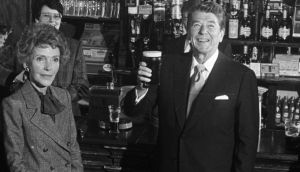 President Ronald Reagan and Ms Nancy Reagan during their visit to Ireland. President Reagan is drinking a pint of Guinness in the Ronald Reagan pub in Ballyporeen, Co Tipperary. File photograph: Pat Langan/The Irish Times