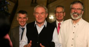 Sinn Féin Deputy First Minister Martin McGuinness (second left) and party leader Gerry Adams  at Stormont: 'There are aspects we can be proud of – it's a good day,' said Adams. Photograph: Brian Lawless/PA Wire.