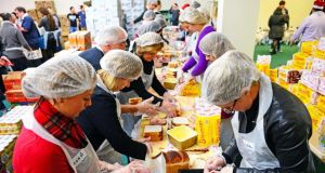 A file photograph of volunteers preparing food and goody bags for distribution, at the annual Christmas Dinner organised by the Knights of  Columbanus. Photograph: Eric Luke/The Irish Times.