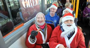 Joan and Aideen Goggin  with passengers on a Cork bus demanding that   a tradition of bus drivers dressing as Santa be reinstated. Pic Daragh Mc Sweeney/Provision