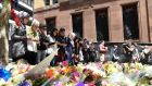 Women from the Muslims and Friends association pay their respects as thousands leave flowers at a memorial outside the Lindt Cafe in Sydney. Photograph: Dean Lewins/EPA
