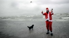 Supporters of the My Lovely Horse Rescue group took to the sea at Dollymount despite appalling weather conditions in their santa outfits to raise funds for animals that suffer wet and cold on a daily basis. Video: Alan Betson