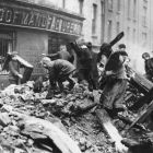 Children collect firewood from rubble of Dublin buildings destroyed during the Easter Rising. Photograph: Central Press/Getty Images