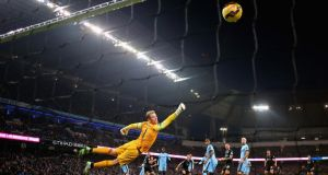 A diving Joe Hart can't keep out Ashley Barnes's equaliser for Burnley against Manchester City at the Etihad Stadium. The goal meant City failed to record a club record 10th consecutive victory. Photograph: Getty Images