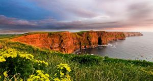 Figures released this week show that 1,075,000 tourists visited Clare's famous cliffs in 2014, an increase of 12.5 per cent since last year. Photograph: Getty Images