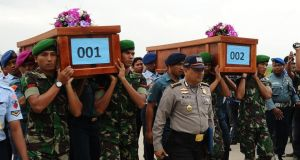 Indonesian soldiers carry coffins containing victims of the AirAsia flight QZ8501 crash at the Indonesian Air Force Military Base Operation Airport  in Surabaya. Photograph: Robertus Pudyanto/Getty Images.
