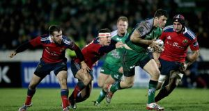 Connacht's Robbie Henshaw gets past JJ Hanrahan, Ian Keatley and Tommy O'Donnell of Munster during the Guinness Pro 12 clash at the Sportsground.    Photograph: James Crombie/Inpho