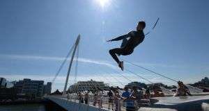 Jumping from the Samuel Beckett Bridge in Dublin's Docklands during warm weather in June 2014.Photograph: Dara Mac Dónaill / The Irish Times