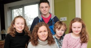 Emer Doyle and her children, from left, Ellie (13), Sean (16), Peter (8) and Mia (9), at their home in Kilcavan, Co Offaly. Photograph: James Flynn/APX