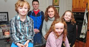 Emer Doyle and her children, from left, Peter (8), Sean (16), Mia (9) and Ellie (13), at their home in Kilcavan, Co Offaly. Photograph: James Flynn/APX