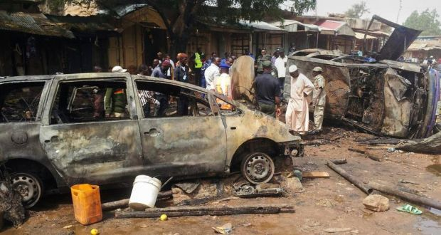 "The aftermath of a Boko Haram  bomb blast at Dukku bus rank in Gombe, Nigeria, in late December in which at least 20 people died and 18 sustained various injuries. In Baga the dead were said to be ""littered on the streets and surrounding bushes"". Photograph: EPA"