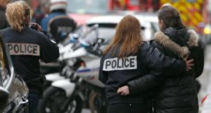 French police assist a woman after a shooting in the street of Montrouge near Paris January 8, 2015. Photograph: Reuters