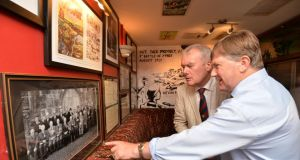 Kevin Myers and Bobby Campion, grand-nephew of Victoria Cross winner Jack Moyney at the official opening of the snug at Bob's Bar in Durrow, Co Laois,which has been transformed into a pub museum in Moyney's honour. Photograph: Alan Betson