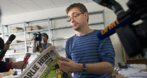 First victim: Stéphane Charbonnier, director of Charlie Hebdo, talks to journalists about one of the satirical magazine's controversial issues, in 2012. Photograph: Fred Dufour/AFP/Getty