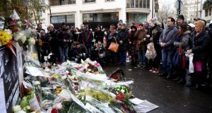 Paying their respects: Parisians outside the Charlie Hebdo offices the day after the attack. Photograph: Marc Piasecki/Getty