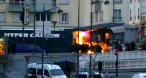 Police detonate flash bangs before raiding the kosher supermarket in Paris where a gunman had held a number of hostages.