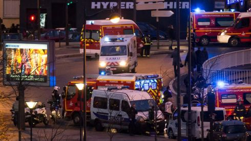 Emergency services at the scene after a hostage crisis in the store in the background was brought to an end in Porte de Vincennes, Paris. Photograph: Ian Langsdon/EPA