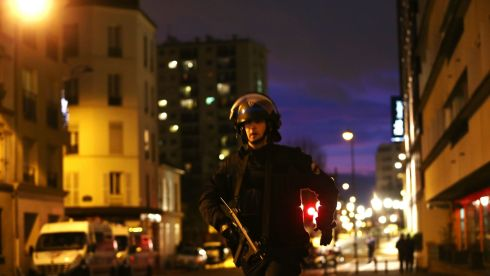 A police officer running near the rapidly unfolding scene of the hostage-taking at Porte de Vincennes, Paris, on January 9th, 2015. Photograph: Dan Kitwood/Getty Images