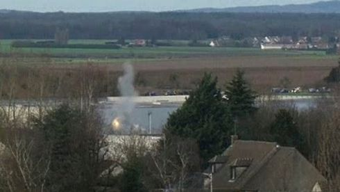 A flash of light and smoke in a video grab from footage of the final assault at the scene of the hostage-taking on January 9th, 2015, at an industrial zone in Dammartin-en-Goele, northeast of Paris.  Photograph: Reuters