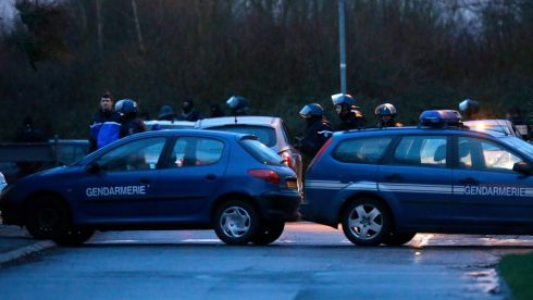 French police officers during an assault at Dammartin-en-Goele, near Paris, on the evening of January 9th, 2015, against  suspects in the shooting attack at satirical French magazine Charlie Hebdo.  Photograph: Etienne Laurent/EPA