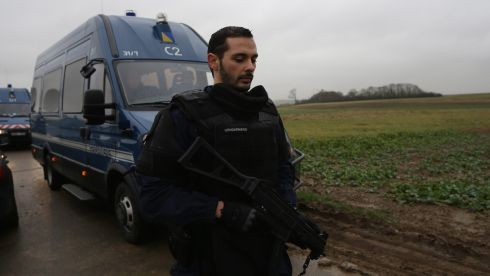 Police reinforcements arrive on a country lane surrounding an industrial estate where suspects linked to the Charlie Hebdo massacre  held a hostage in Dammartin-en-Goele, France. Photograph: Christopher Furlong/Getty Images