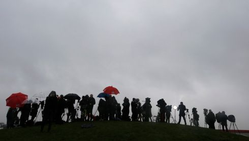 Journalists stand near an industrial zone in Dammartin-en-Goele, where the two main suspects in the Charlie Hebdo killings were sighted. Photograph: REUTERS/Eric Gaillard