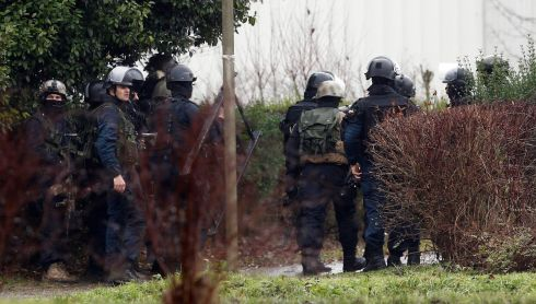 Police officers gather in assault equipment following the hunt for the two Paris attackers. There was an exchange of fire, according to media reports.  Photograph: EPA/ETIENNE LAURENT