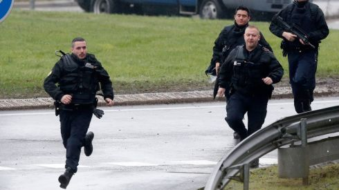 Members of the French gendarmerie intervention forces arrive at the scene of a hostage taking at an industrial zone in Dammartin-en-Goele, northeast of Paris January 9th, 2015. The two main suspects in the Charlie Hebdo magazine killings were sighted in the northern French town of Dammartin-en-Goele where at least one person was taken hostage, a police source said. Photogaph: REUTERS/Christian Hartmann