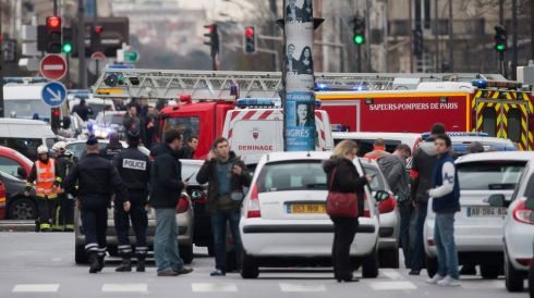 Police set up a security perimeter near Porte de Vincennes in Eastern Paris after a man opened fire and took hostages. Photograph: Ian Langsdon/EPA