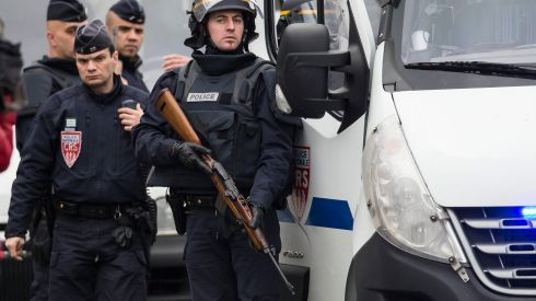 Police await developments at Porte de Vincennes. Photograph: Ian Langsdon/EPA