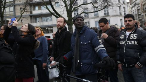 People watch as the Porte de Vincennes hostage incident unfolds. Photograph: Dan Kitwood/Getty Images