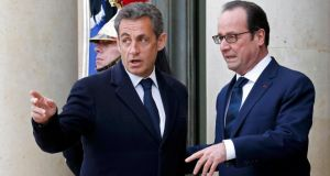French president Francois Hollande (R) welcomes former French president Nicolas Sarkozy, head of the French conservative party UMP party (L) at the Elysee Palace before Sunday's rally. Photograph: Reuters