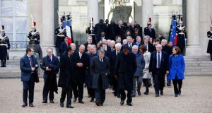 The presidents and politicians invited by French president Francois Hollande leave the Elysée Palace to participate in a march to honor the victims of the terrorist attacks  in Paris on Sunday.   Photograph: EPA