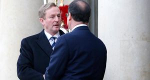 Taoiseach Enda Kenny meets French president Francois Hollande  at the Elysée Palace before the rally to honor victims of the terrorist attacks in Paris. Photograph: EPA