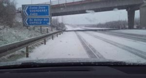 Snow falling on the M4 outside Enfield on Tuesday morning. Photograph: Tommy O'Rourke.