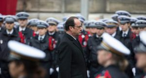 President Francois Hollande attends a national tribute at the Paris Prefecture for the three police officers killed during last week's attacks by Islamic militants, on Tuesday. Photograph: Reuters