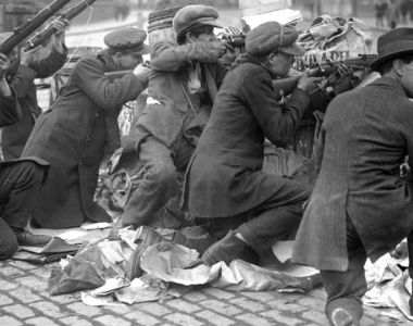 "Manning the barricades during the Easter Rising – ""independence was secured by violent struggle, in which most of those killed were Irish"". – Photograph:   Walter Doughty, the Manchester Guardian's first staff photographer."