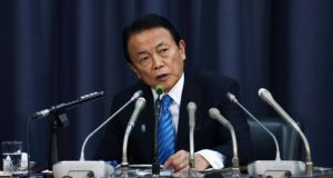 Taro Aso, Japan's deputy prime minister and finance minister, speaks during a news conference announcing the governments planned military spending. Photograph: Tomohiro Ohsumi/Bloomberg