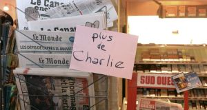 "A sign which translates as ""Charlie Hebdo - Sold Out"" is displayed at a newsagents in Bordeaux. Photograph: AFP/Getty/Hean Pierre Muller."