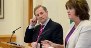 Taoiseach Enda Kenny and  Tánaiste Joan Burton  at a press conference after Cabinet meeting on jobs. Photograph: Dara Mac Dónaill/The Irish Times