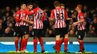 Shane Long (second from left) is congratulated by his Southampton team-mates after opening the scoring in the FA Cup third-round replay against Ipswich Town at   Portman Road. Photograph: Shaun Botterill/Getty Images