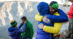 From left: Becca and Tommy Caldwell, and Jacqui Becker and Kevin Jorgeson embrace after the two men completed a free climb summit of the Dawn Wall of El Capitan. Photograph: Max Whittaker/The New York Times