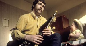 Finbar Furey playing the uilleann pipes to his daughter in the late 1960s. Photograph: Brian Shuel/Redferns
